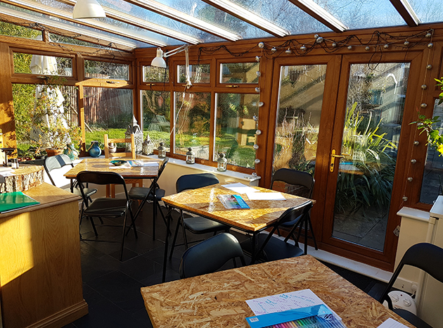 Conservatory in daylight with tables set up